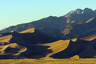 San Luis Valley - Great Sand Dunes National Park and Preserve in Colorado sits directly west of the Sangre de Cristo Range, which is featured in the background.