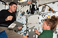 STS-135 Rex Walheim and Sandy Magnus.jpg