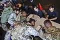 Sailors process service members evacuated from St. Thomas. (37130911892).jpg