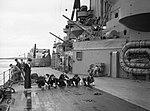 Sailors scrubbing the deck on board HMS RODNEY, 1940. A125.jpg