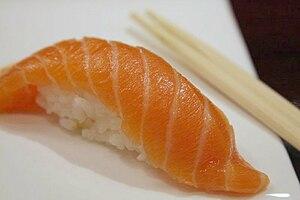Salmon Nigiri Sushi with chopsticks, 2008.