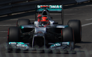 2012 Monaco Grand Prix - Michael Schumacher celebrates setting the fastest time in qualifying, but he would drop 5 grid spaces due to his collision in Spain. He later retired from the race.