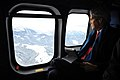 Secretary Kerry Looks Out at Swiss Landscape on Flight to Davos (12102789654).jpg