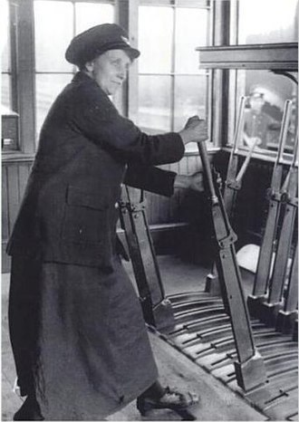 Signalman (rail) - Signalwoman in a Great Central cabin near Birmingham, England, 1918