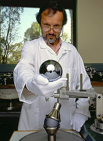 Avogadro constant - Achim Leistner at the Australian Centre for Precision Optics (ACPO) holding a one-kilogram single-crystal silicon sphere prepared for the International Avogadro Coordination.