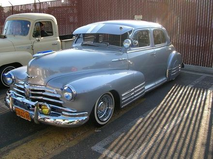Lowrider began in the Mexican-American Barrios of Los Angeles California in the mid-to-late 1940s and during the post-war prosperity of the 1950s. Initially, some youths would place sandbags in the trunk of their customized cars in order to create a lowered effect. Solo s 48 Fleetline.jpg