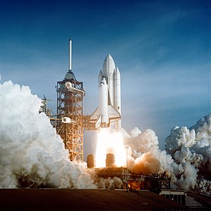 Space Age - The Space Shuttle lifts off on a manned mission to space.