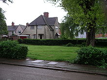 Larkin's parents' former Radford council house overlooks a small spinney, once their garden. The spinney is on the corner of two roads. It is a lawn, maintained by the Coventry City Council groundsmen, with some mature trees and bushes around the perimeter as seen in 2008