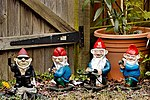 Spring is here, and so our garden gnomes have come out of hibernation -) (33666377931).jpg