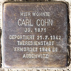 Photo of Carl Cohn brass plaque