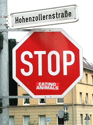 "English: ""Stop eating animals"" - Veg..."