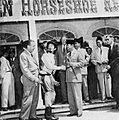 Sukarno in front of Golden Horseshoe Saloon, Aneka Amerika 102 (1957), p33.jpg