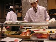 Sushi chef preparing Nigirizushi, Kyoto, Japan.