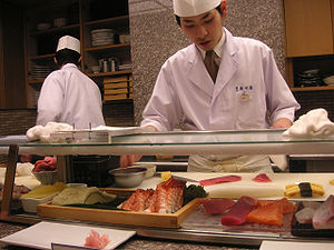 English: Sushi chef working in a restaurant in...