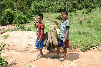 Ta Oi people - Ta Oi boys with fish traps, Salavan Province, Laos