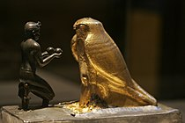 Taharqa presenting god Hemen with wine E25276 mp3h9203.jpg