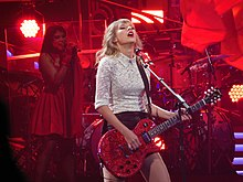 Taylor with guitar