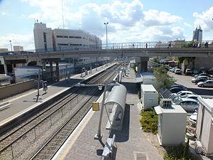 Haifa Center HaShmona railway station - Pedestrians on the bridge connecting the port of Haifa's passenger terminal with Ha'Atzma'ut Road and Haifa Center railway station.