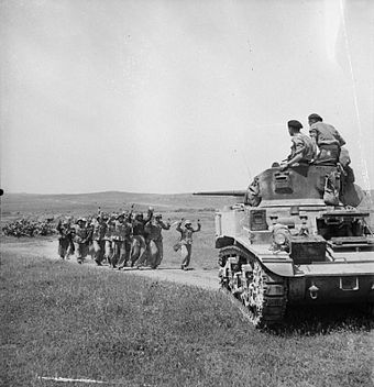 German troops surrender to British crew of a Stuart tank near Frendj, 6 May 1943. The British Army in Tunisia 1943 NA2514.jpg