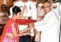 The President, Shri Pranab Mukherjee presenting the Padma Shri Award to Smt Malini Awasthi, at a Civil Investiture Ceremony, at Rashtrapati Bhavan, in New Delhi on March 28, 2016.jpg