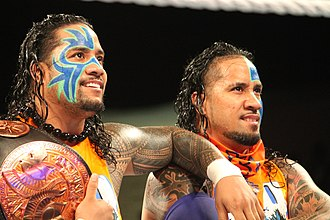 The Usos - The Usos (Jimmy on left, Jey on right) in September 2014