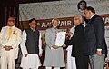 The Vice President, Shri Mohd. Hamid Ansari presenting the 13th A.K. Nair Memorial Award to the Principal Secretary to Prime Minister, Shri T.K.A. Nair, at Kannur, in Kerala on July 10, 2010 (1).jpg