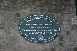 Longest tennis match records - A plaque commemorating the Isner–Mahut match on Court 18 at Wimbledon.