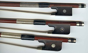 Violin, viola, and cello bow frogs (top to bottom)