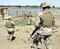 Three marines patrol along the Euphrates River during Operation Iron Fist.jpg
