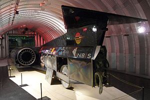 ThrustSSC - Rear view of ThrustSSC, with a panel removed to show one of its four aluminium alloy wheels, in the Coventry Transport Museum