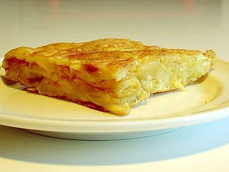 Spanish omelette - A portion of Spanish tortilla. Thickness and texture varies according to region or taste.