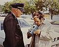 Transportation Systems Center Staff Member Demonstrates Alcohol Breath Analyzer - NARA - 6882631.jpg