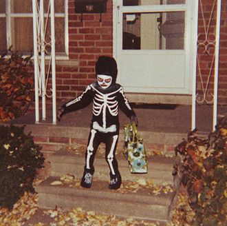 Trick-or-treating - Photograph of a child dressed as a skeleton trick-or-treating in Redford, Michigan on October 31, 1979