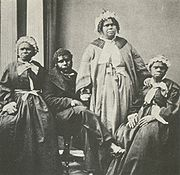 A picture of the last four Tasmanian Aborigines c.1860s. Truganini, the last to survive, is seated at far right.