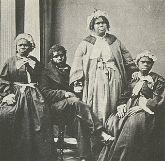 Four elderly full-blood Tasmanian Aborigines c. 1860s. Truganini, for many years claimed to be the last full-blood Aboriginal to survive, is seated at far right. Truganini and last 4 tasmanian aborigines.jpg