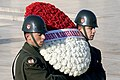 Turkish service members carry a wreath.JPG
