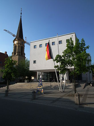 2011 in Germany - A Church and Rathaus (town hall) backdrop the German flag and construction in Nußloch, Baden-Württemberg. (2011)