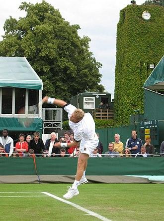 Dmitry Tursunov - Serving at Wimbledon 2007.