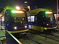 Two Green Line trains at night.jpg