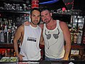 Two men in tank tops at The Music Box in Queens.jpg