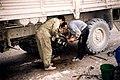 Two men istalling a new widget on a Kamaz truck in Tajikistan.jpg