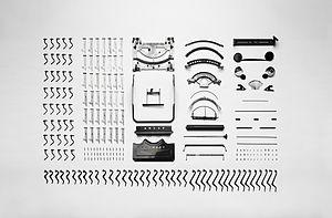 Typewriter - Disassembled parts of an Adler Favorit mechanical typewriter