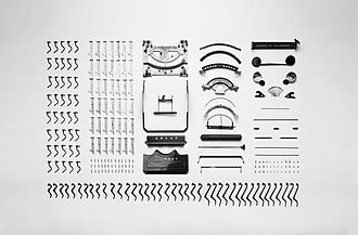 Typewriter - Disassembled parts of an Adler Favorit mechanical typewriter