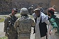 U.S. Army Capt. Alex A. Kaivan, left, the commander of Baker Company, 1st Battalion, 506th Infantry Regiment, 4th Brigade Combat Team, 101st Airborne Division, speaks with residents in Paktia province 130529-A-CW939-106.jpg