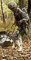 U.S. Army Capt. Vetina Willie, an Expert Field Medical Badge (EFMB) candidate with the 82nd Headquarters and Headquarters Battalion, drags a simulated patient to a safe extraction point during the EFMB 131104-A-KS175-023.jpg