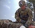 U.S. Army Sgt. Alexander Cerney, top, an infantryman with the 4th Brigade Special Troops Battalion, 4th Brigade Combat Team, 101st Airborne Division, places a tourniquet on a simulated casualty during 130714-A-DQ133-520.jpg