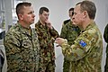 U.S. Marine Corps Chief Warrant Officer 4 Martin Dankanich, left, the officer in charge and team captain of the III Marine Expeditionary Force combat shooting team, speaks with Australian Chief of Army Lt. Gen 120513-F-MQ656-201.jpg