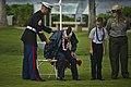 U.S. Marine Corps Staff Sgt. Stephen Cameron, left, assigned to Marine Aviation Logistics Squadron (MALS) 24, assists former Navy Signalman 1st Class Paul Goodyear, center left, a Pearl Harbor survivor and World 121207-F-MQ656-378.jpg