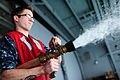 U.S. Navy Aviation Ordnanceman Airman Apprentice James Simonschurch discharges a hose during hydrostatic tests aboard the aircraft carrier USS George H.W. Bush (CVN 77) in the Atlantic Ocean May 23, 2013 130523-N-XE109-185.jpg