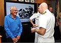 U.S. Navy Capt. Eric Law, front right, assigned to the U.S. Pacific Command Joint Intelligence Operations Center, speaks with Ewalt Shatz, a survivor of the attack on Pearl Harbor, during a Pearl Harbor memorial 131206-N-QN361-033.jpg